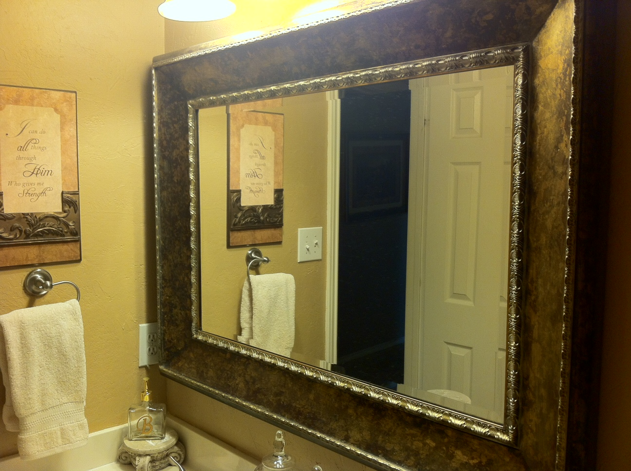 Designer tricks of the trade bathroom re design designs for Giant framed mirror