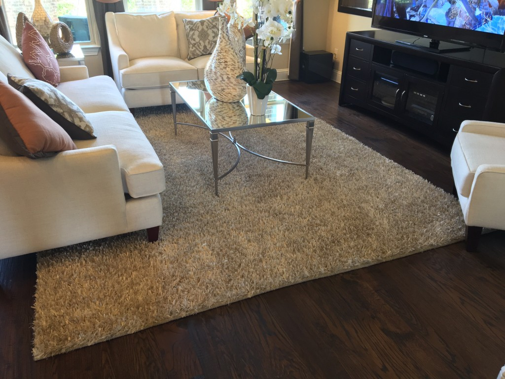 3 quick tips on proper rug placement designs by tamela for Living room area rug placement